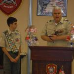 North Naples Fire Chief presenting Eagle statue to David Rose, Troop #2001, 05.22.2016